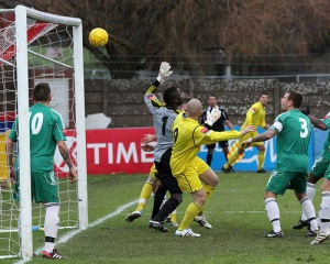 Max hides behind the bemused Hendon Keeper