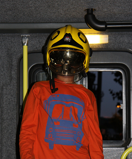 Alasdair Tries On A Firefighter's Helmet