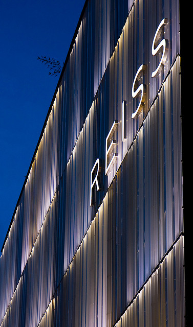 White lighting emphasises the design of the building at night.