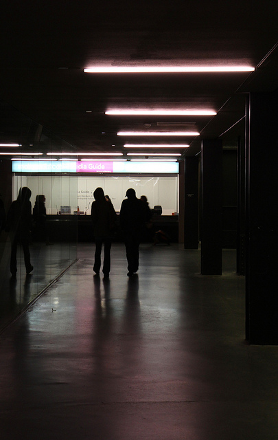 Muted lighting - a walkway inside the Tate Modern.