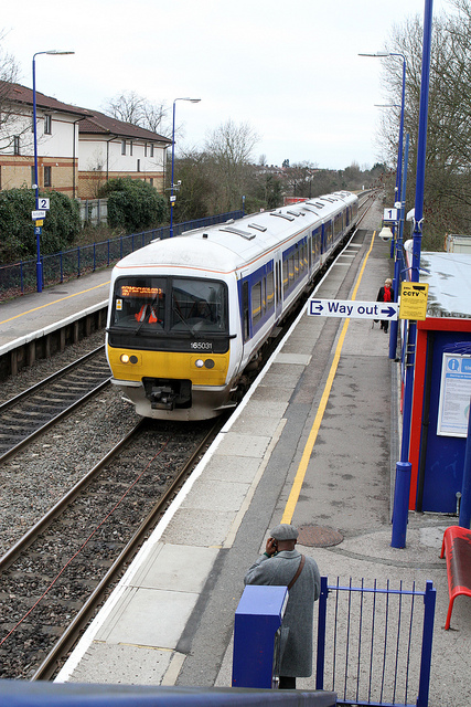 165031 calls at Northolt Park station with the 13:54 service to Marylebone from High Wycombe