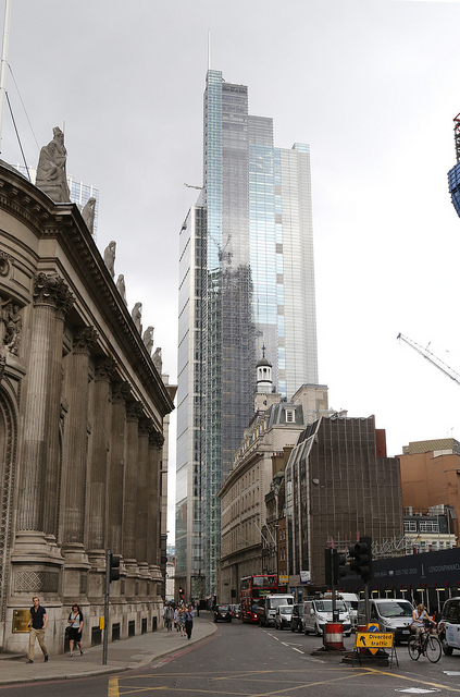 Heron Tower - designed by Kohn Pedersen Fox - looms over Bishopsgate and reflects work in progress on The Pinnacle.