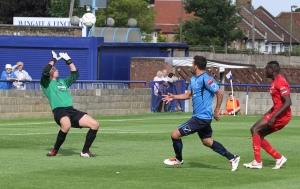 Ahmet chips the ball over McEntegart.