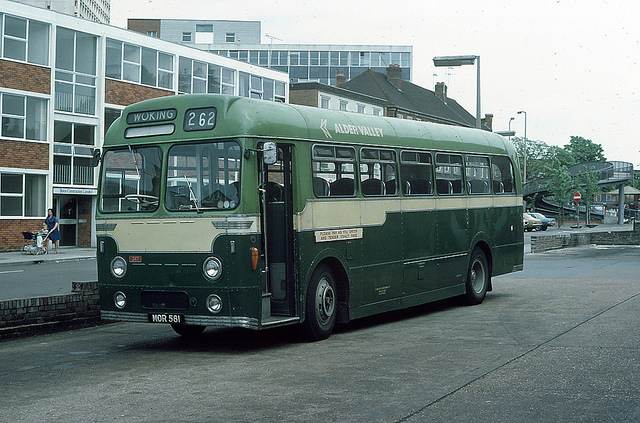 Alder Valley AEC Reliance 347 at Woking in 1976.   Alder Valley was a merger within the National Bus Company of the Thames Valley and Aldershot & District bus companies.   The colour chosen for the vehicles was NBC's poppy red.   Thames Valley's vehicles were Red & Cream,   This is an ex Aldershot 7 District vehicle displaying their Green & Cream livery.