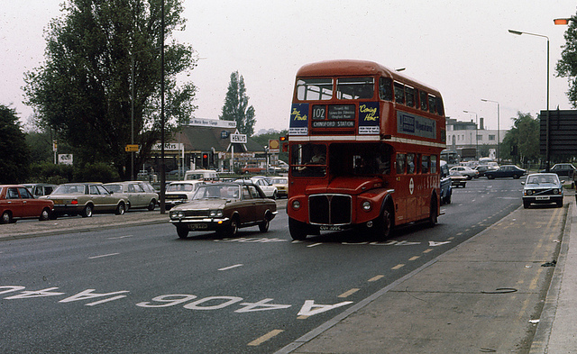 RML2300 at Henlys Corner - very close to home but a rare shot with Henlys Garage visible - the garage was demolished in 1989.   The 102 still runs but with Enviro 400's rather than Routemasters