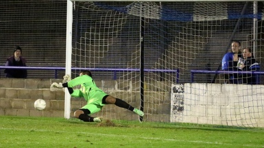 The save that never was :-( Cain pushes the first Witham penalty away