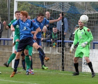 Jasper heads a corner clear against Hitchin