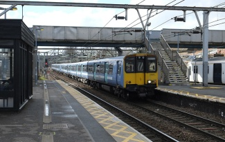 315820 arrives at Ilford with a Shenfield service