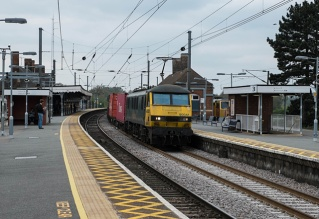90041 heads the 4L97 Trafford Park to Felixstowe North Freightliner service through Manningtree Station