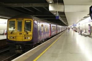 A Class 319 stands in St.Pancras International Station.