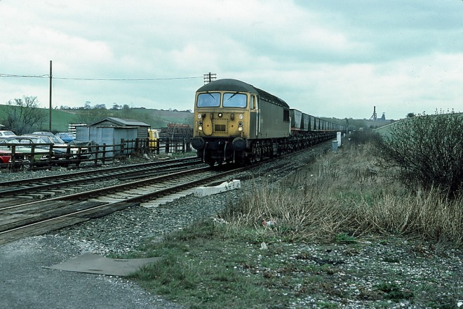 56024 on merry-go-round traffic at Crofton.   The class had been in service for only 8 years when the miners strike of 1984-5 and the subsequent closure of many of Britains coal mines saw them without the work they were designed for.   Sharlston Colliery on the distant horizon closed in 1993 and was reduced to a wasteland.