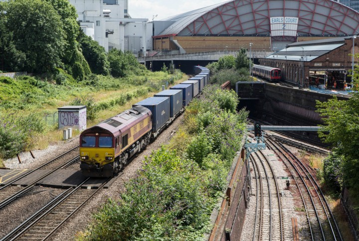 Beside a Railway Line anywhere watching the trains - 66250 passes through Earls Court.