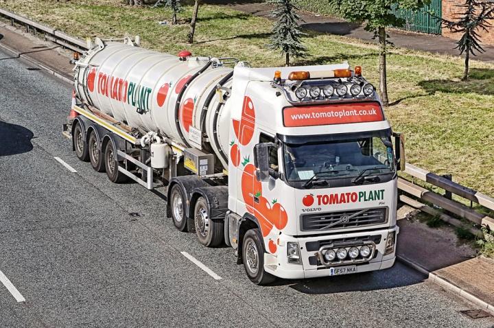 Tomato Plant Volvo GF57NKA passes through Finchley.